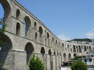 What other empire is known for its aquaducts and system of roads and bridges?
